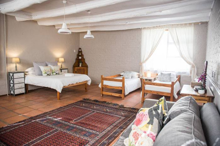 Secluded Getaways in The Cape: Rivers Own Guest Lodge Bedroom