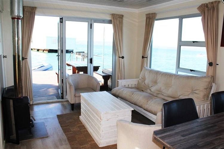 Secluded Getaways in The Cape: Serenity Houseboat Living Area